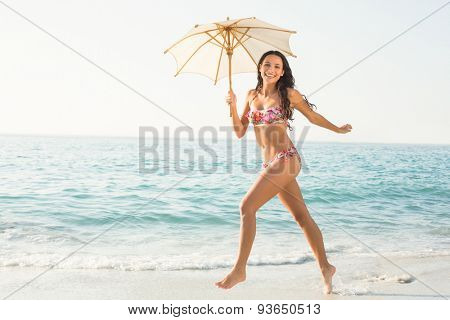 pretty brunette in swimsuit at the beach