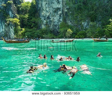 KrabiThailand-April 212015:Tourists enjoy with snorkeling in a tropical sea at Phi Phi island in Krabi Thailand