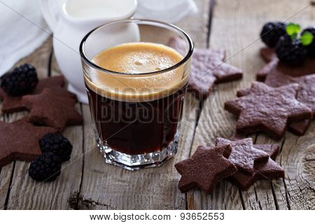 Coffee in a glass with chocolate cookies