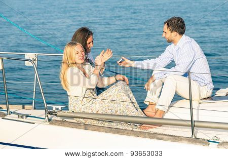 Young People Having Fun With Smartphone On Exclusive Luxury Sailing Boat