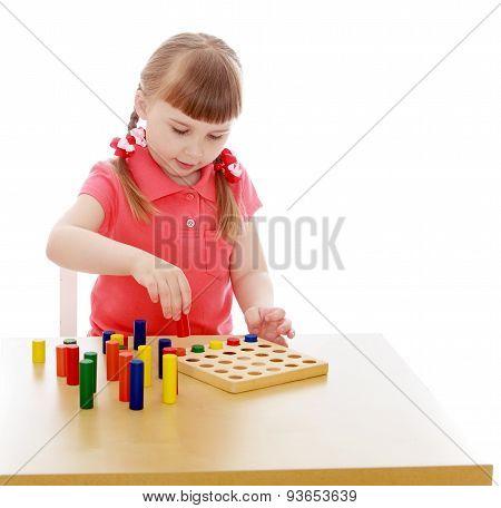 Very smart girl blonde in Montessori kindergarten