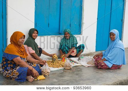 Group Of Women Selling Tropical Fruit