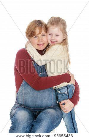Little girl hugging your favorite pregnant mother , close-up