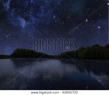 The big wood lake at night with sky with stars. Elements of this image furnished by NASA