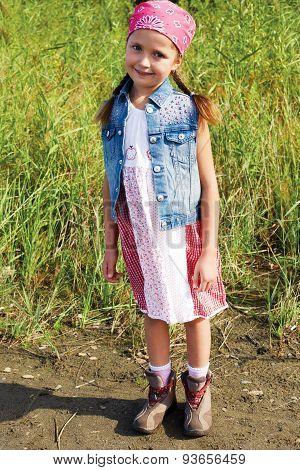 Little American Girl Standing In A Cornfield