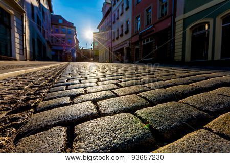 Sunrise in a city street with paving stones