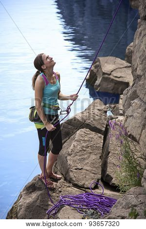 Belaying female climber