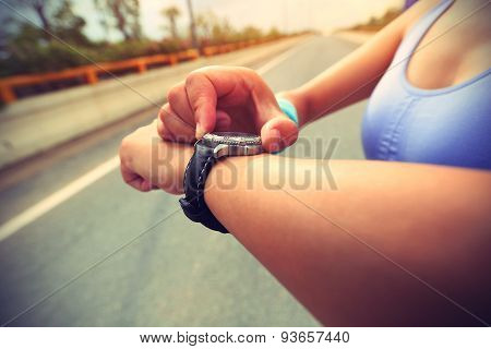 young woman jogger ready to run