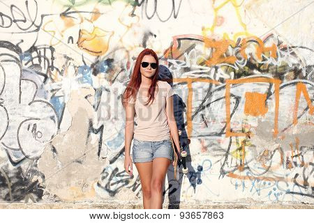 Sitting Girl With Roller Skates On urban wall Background