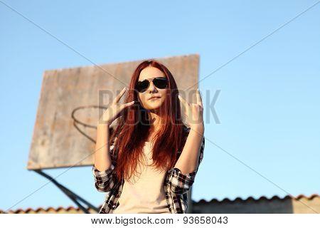 Girl Showing Symbol Of Rock Music