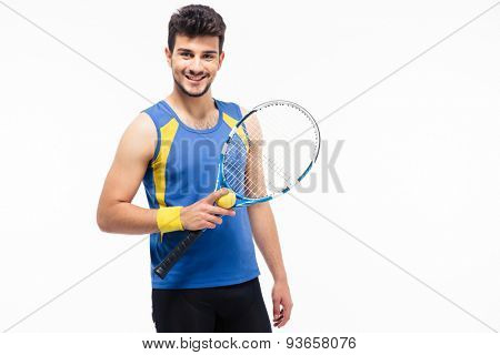 Cheerful man holding tennis racket and ball isolated on a white background. Looking at camera