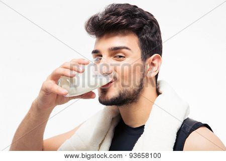 Fitness man drinking milk isolated on a white background