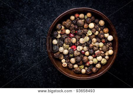 Peppercorns In A Wooden Bowl