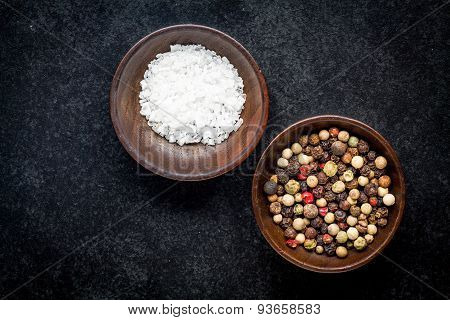 Peppercorns And Sea Salt In A Wooden Bowl