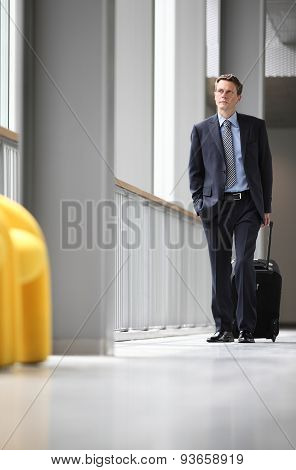 businessman walking with trolley, business travel