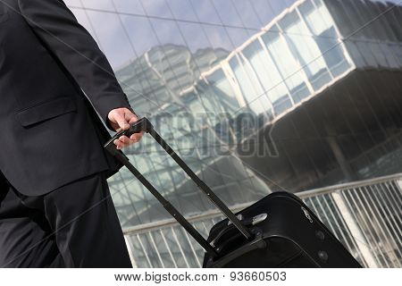 hand of businessman walking with trolley, business travel