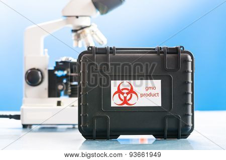 Safe case with GMO product and microscope in laboratory. Design of the label is specially created for this shot.