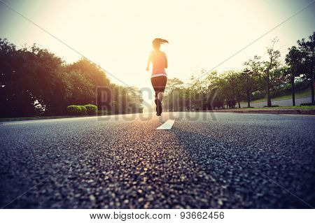 Runner athlete running at road. woman fitness sunrise jogging workout wellness concept. vintage effe
