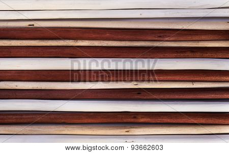 Wooden background from painted white, ivory and brown twigs