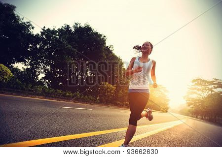 Runner athlete running at road. woman fitness sunrise jogging workout wellness concept.vintage effec