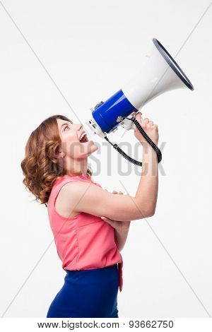 Casual woman shouting in megaphone isolated on a white background