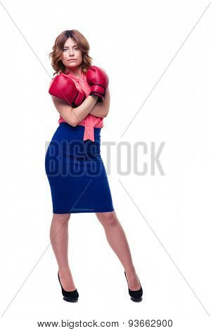 ELegant businesswoman standing in boxing gloves isolated on a white background. Looking at camera