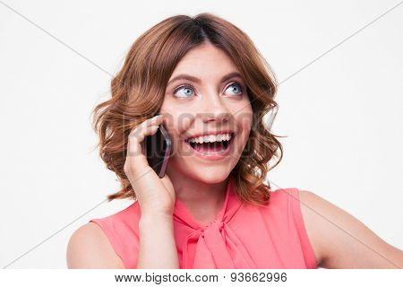 Laughing woman talking on the phone isolated on a white background and looking up