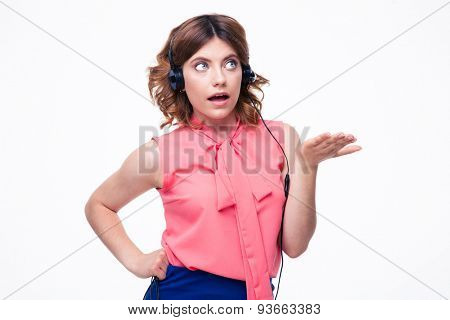 Portrait of shocked female customer operator isolated on a white background