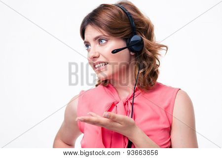 Portrait of unhappy female customer operator isolated on a white background