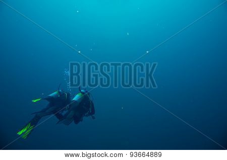 Couple of scuba divers set out on an underwater adventure. Red Sea