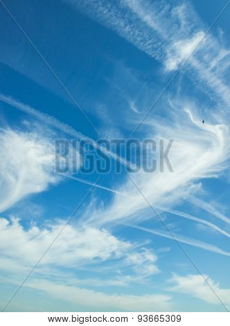 White clouds in a blue sky. Great vertical background