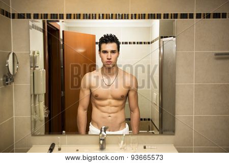 Shirtless handsome young man in bathroom
