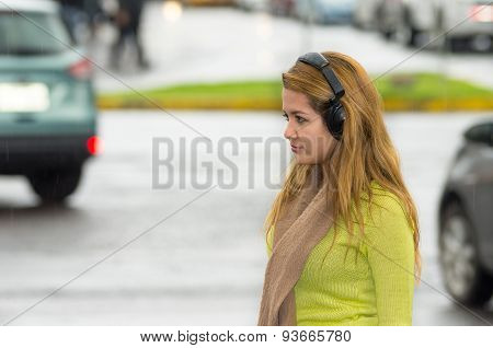 Woman outdoors listening to music