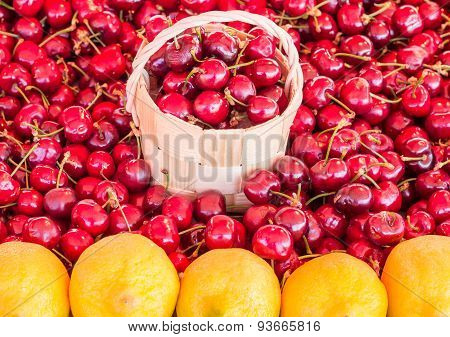Basket Of Cherries In A Cherry Background