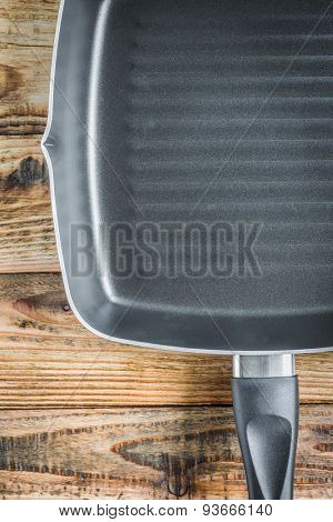 Grill pan on wood
