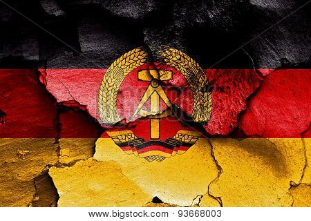 Flag Of East Germany Painted On Cracked Wall