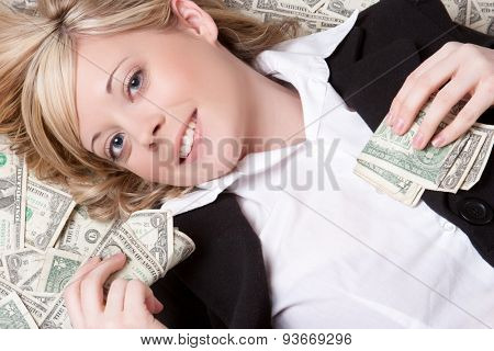 Smiling woman laying in money