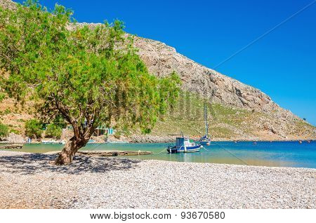 Greek pebble beach in quiet bay, Aegean Sea Greece