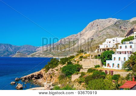 Typical Greek houses on coast of Aegean Sea Greece