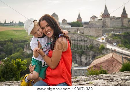 Mom and son travel.