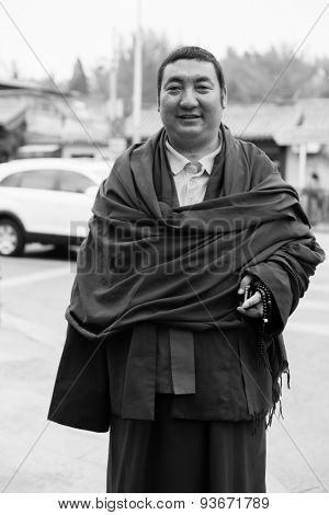BEIJING, CHINA - APRIL 28:, 2013 Unidentified Monk posing on street of Beijing. Beijing  is the capital of the People's Republic of China and one of the most populous cities in the world