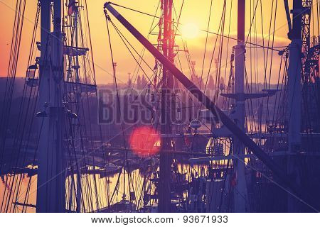 Vintage Toned Sunrise Over Harbor.