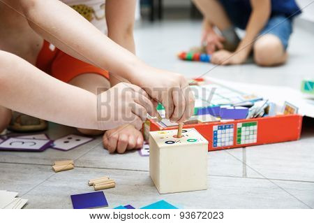 Children Playing With Homemade Educational Toys