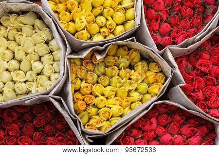 Colorful roses wrapped in newspaper at the Bangkok flower market, Thailand