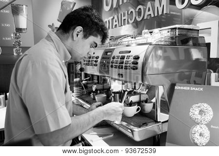 GENEVA, SWITZERLAND - SEPTEMBER 11, 2014: barmen prepare coffee. Geneva is the second most populous city in Switzerland and is the most populous city of Romandy
