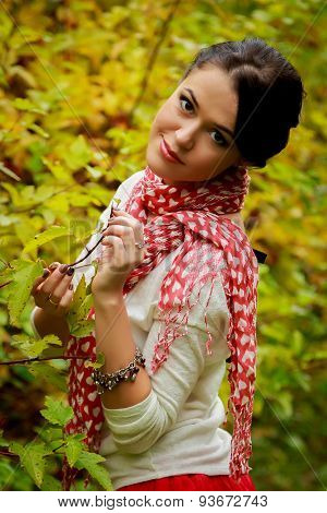 Young woman in beautiful autumn park,