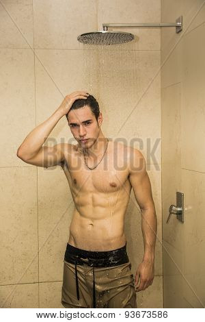 Attractive Young Muscular Man Taking Shower
