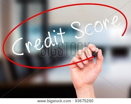 Man Hand writing Credit Score black marker on visual screen.