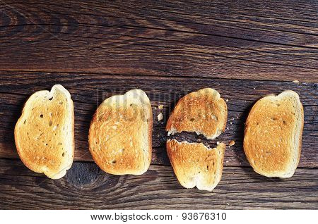 Three Slices Toasted Bread And One Ripped