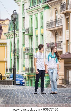 Girl and guy on the streets of European cities.
